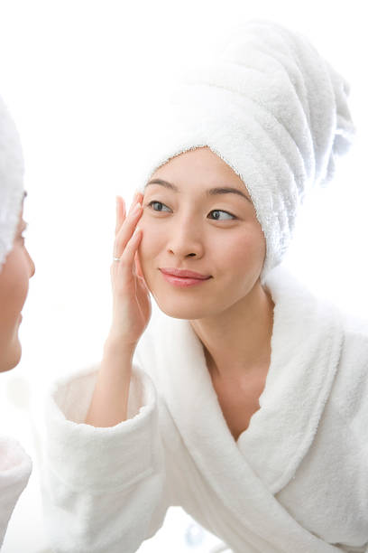 Woman taking care of her skin stock photo