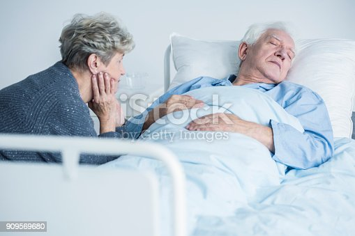 829742744istockphoto Woman taking care of husband 909569680