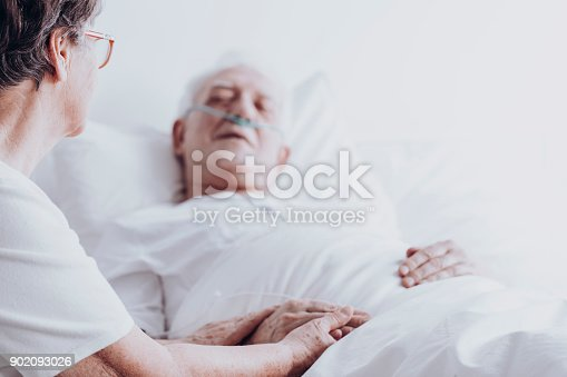 886711404 istock photo Woman taking care of man 902093026