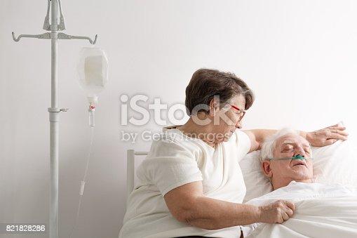 909569706istockphoto Woman taking care of sick husband 821828286