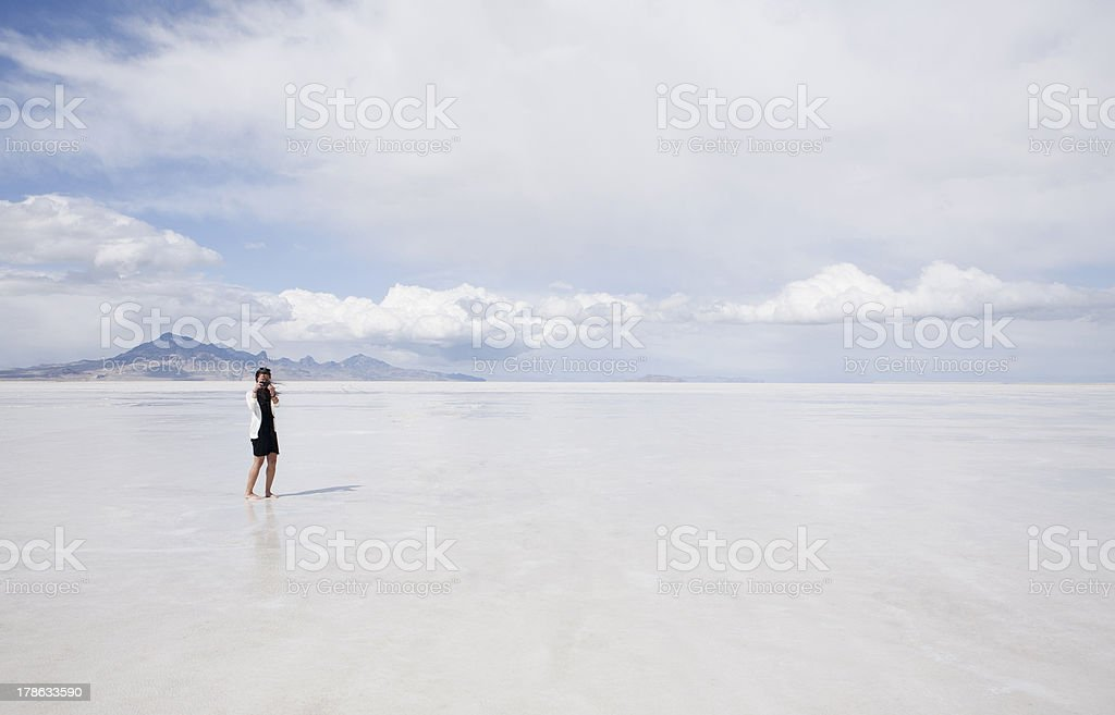 Woman taking cell phone photo on the Bonneville Salt Flats stock photo