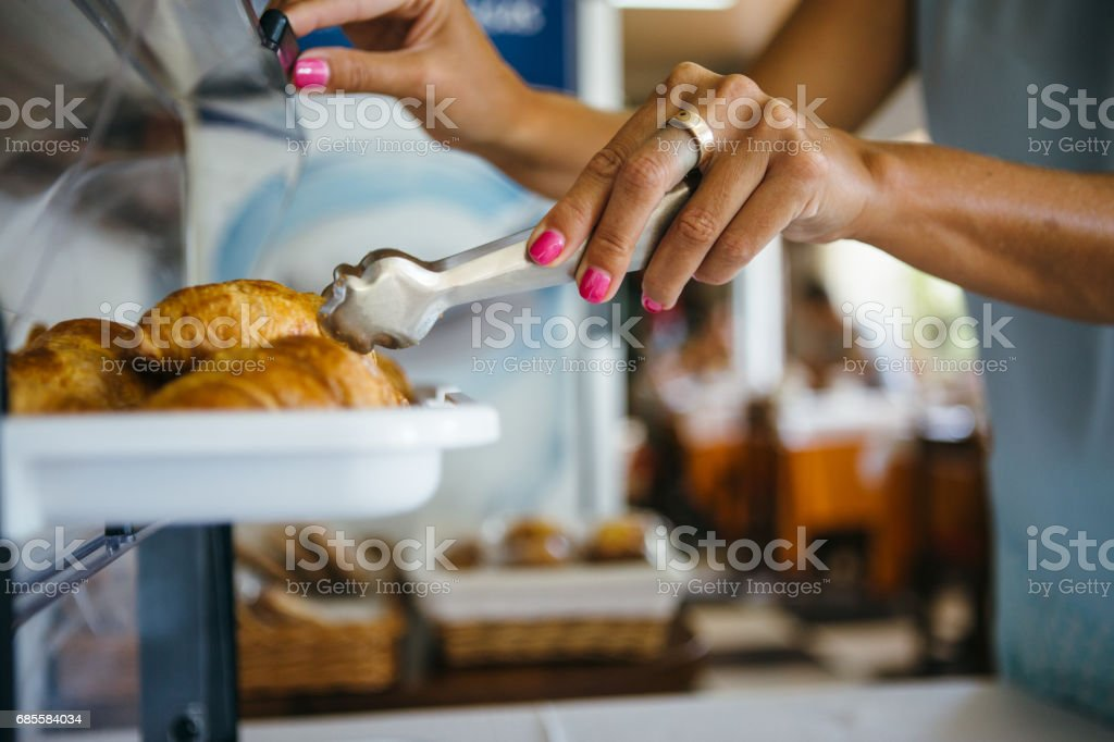 Woman taking croissant royalty-free stock photo