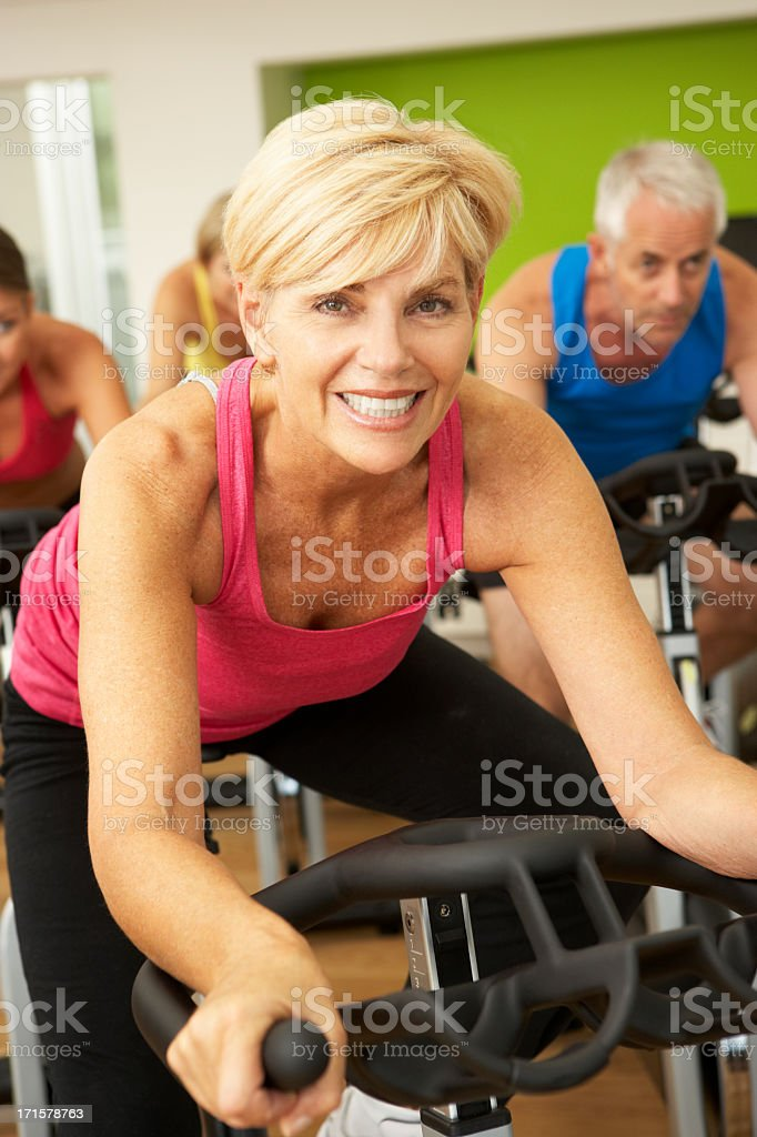 Woman Taking Doing Spinning Class In Gym royalty-free stock photo