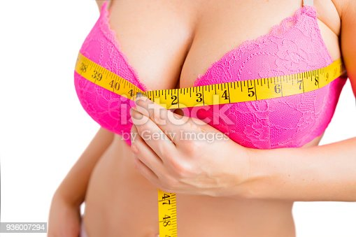 498310066istockphoto Woman taking her bra measurements 936007294