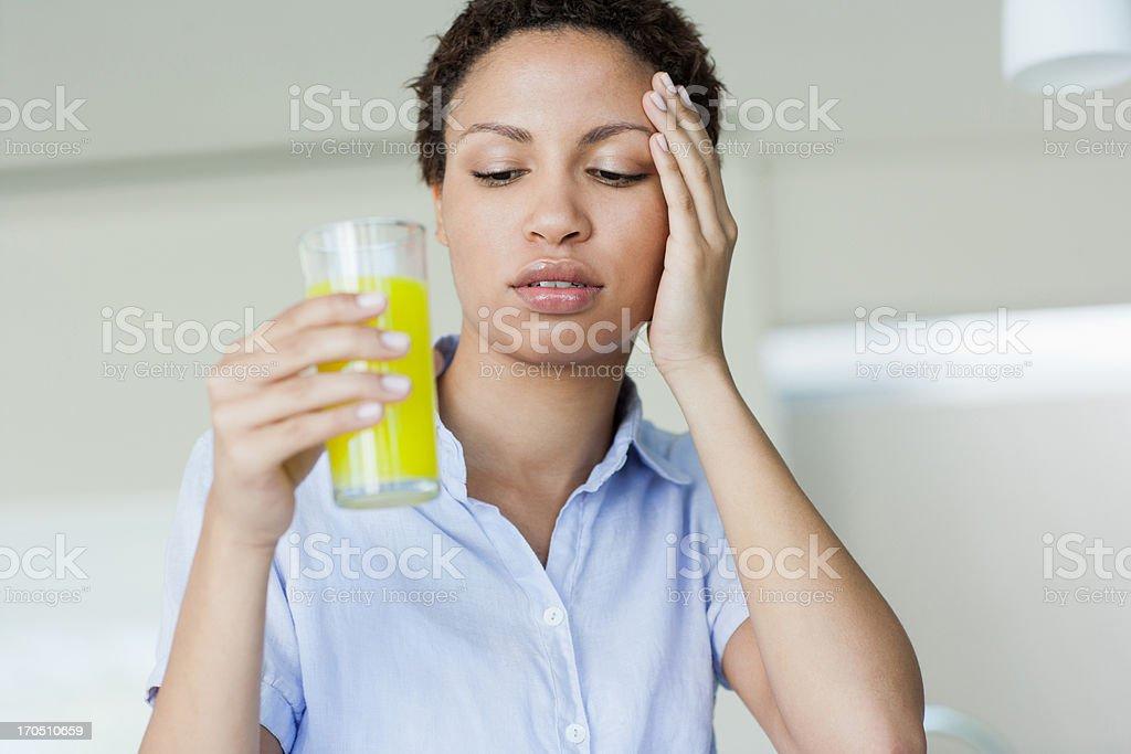 Woman taking juice royalty-free stock photo