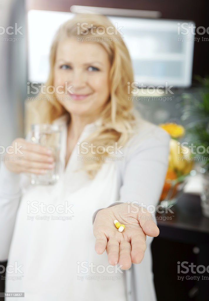 Woman taking medicine. royalty-free stock photo