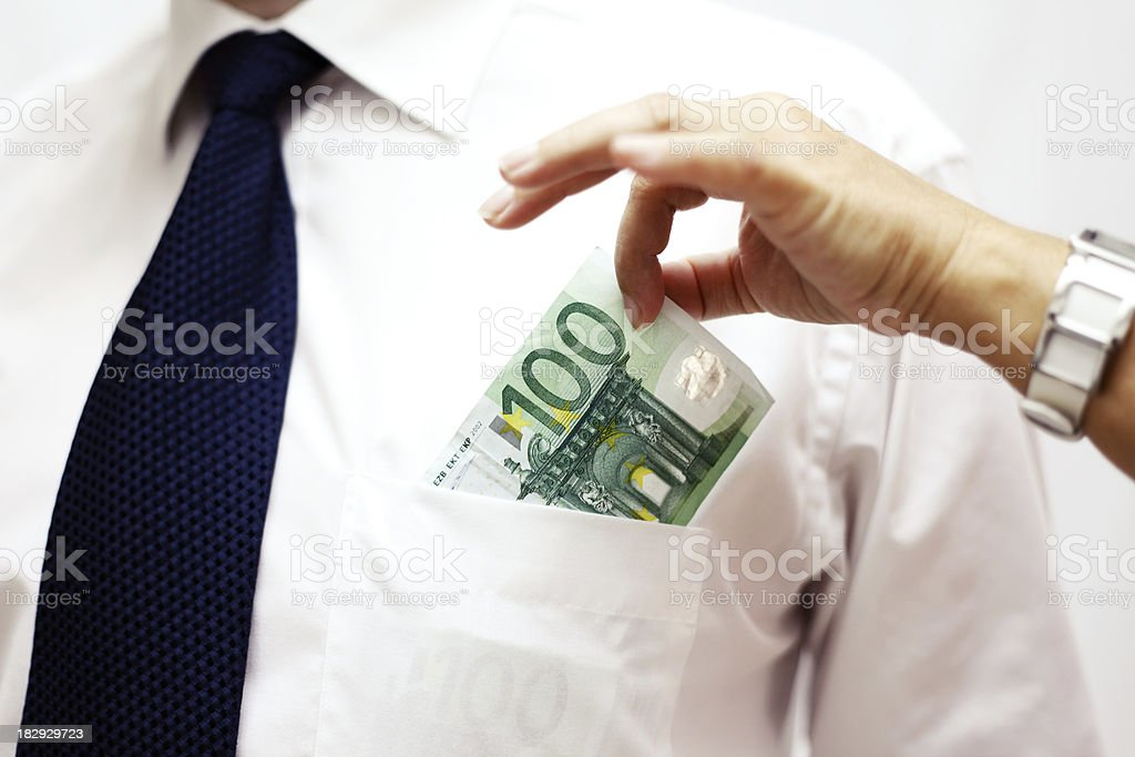 Woman Taking Money Out of a Man's Pocket royalty-free stock photo