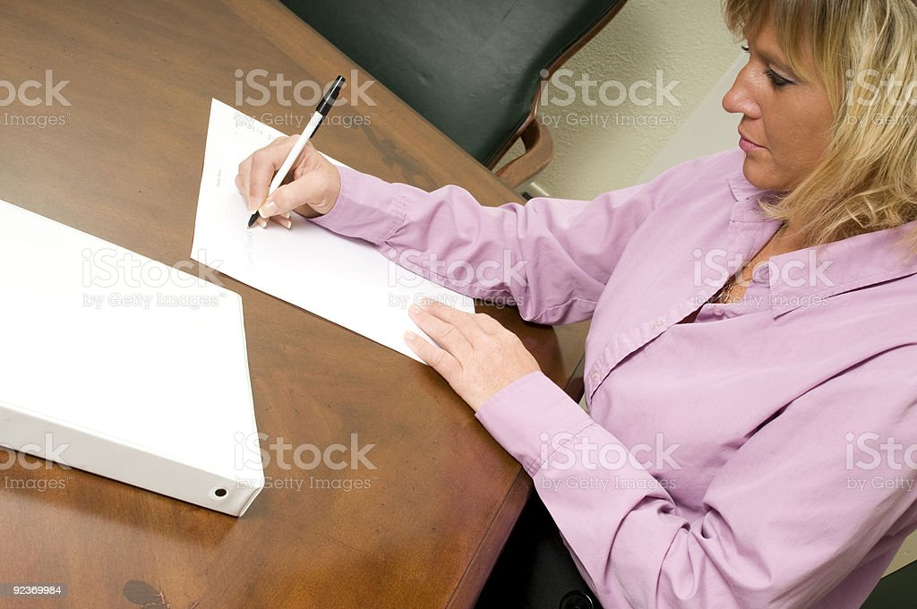 woman taking notes royalty-free stock photo