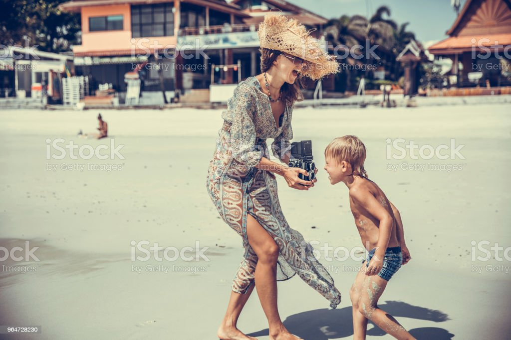 Woman taking photo of her kid royalty-free stock photo