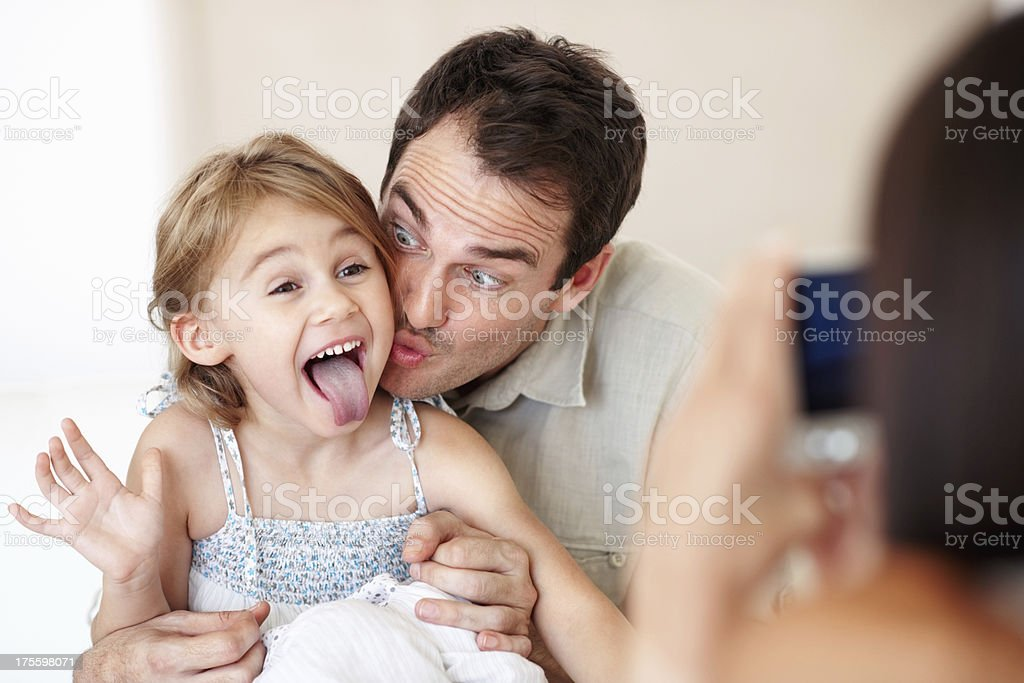 Woman taking photo of husband and daughter royalty-free stock photo