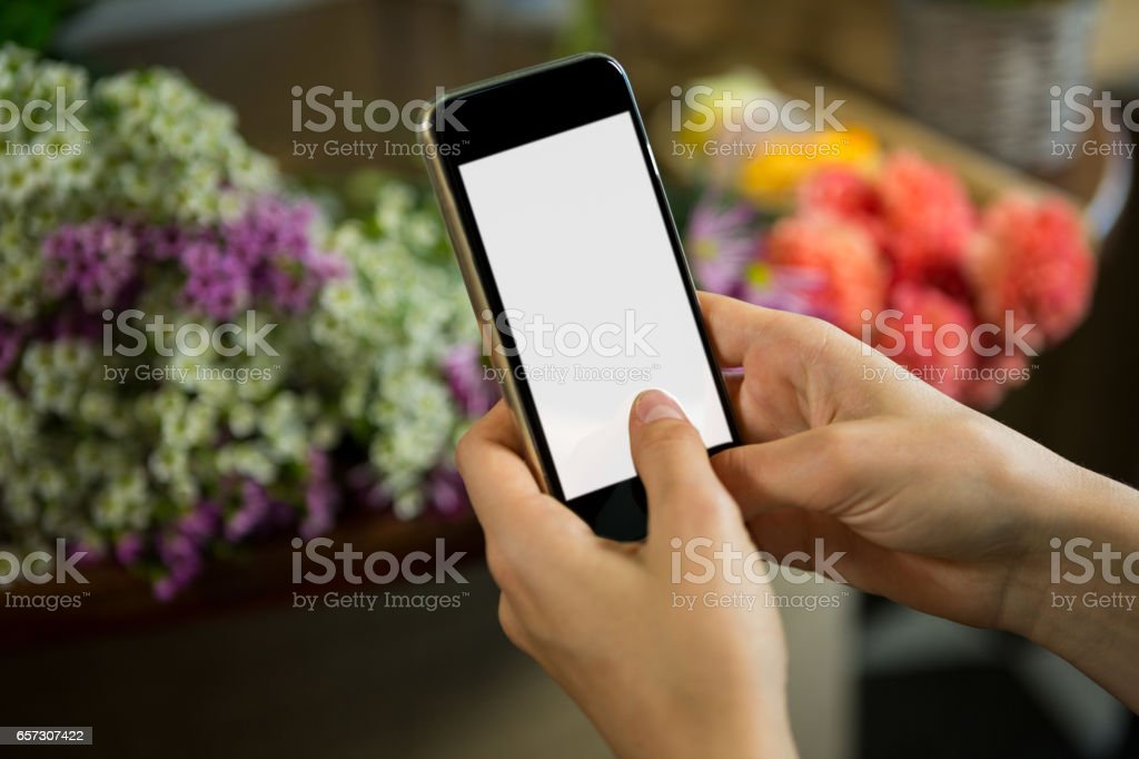 Woman taking photograph of flower bouquet stock photo