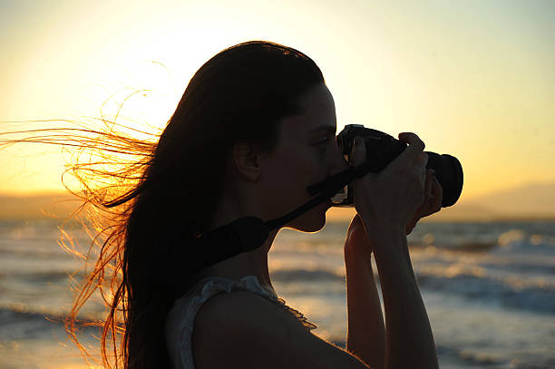 woman taking photographs