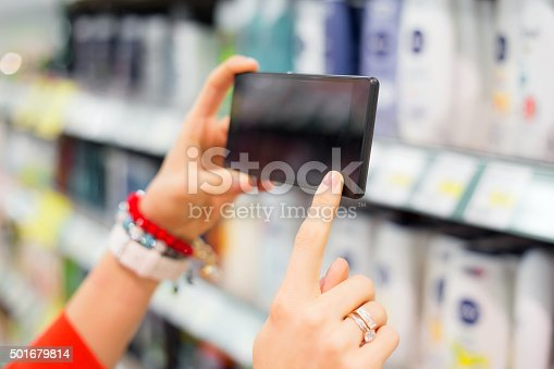 1184048369 istock photo Woman taking picture in supermarket 501679814