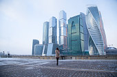 Woman taking picture of highrise in Moscow city
