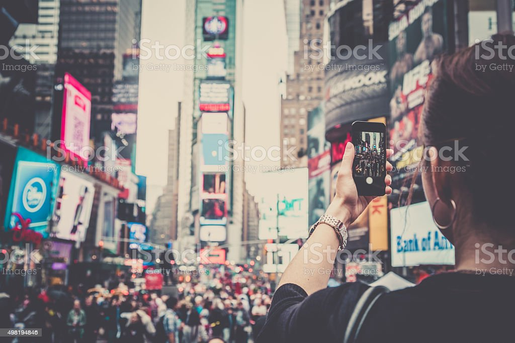 Woman Taking Picture With Mobile Phone at Times Squares, NYC stock photo