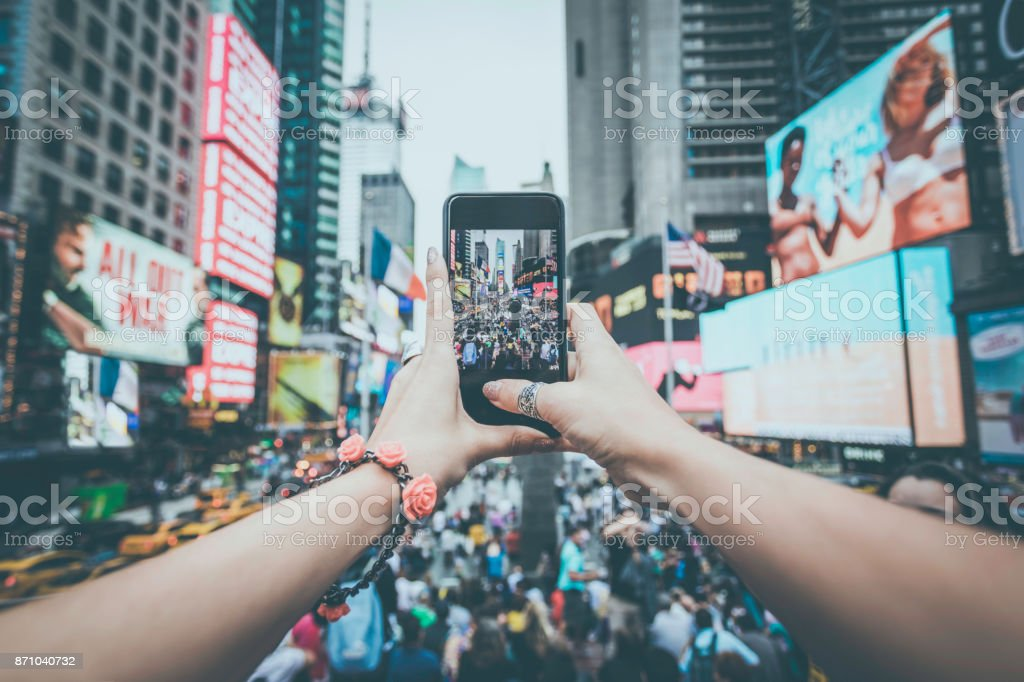 POV Woman Taking Picture With Mobile Phone at Times Squares, NYC stock photo