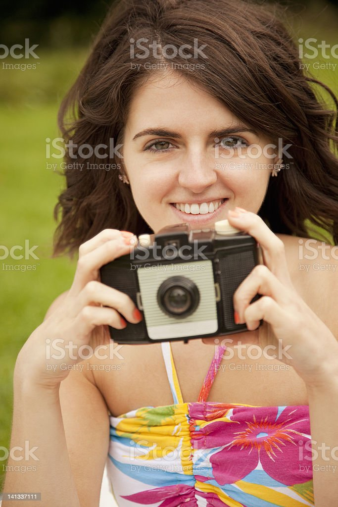 Woman taking pictures in park royalty-free stock photo