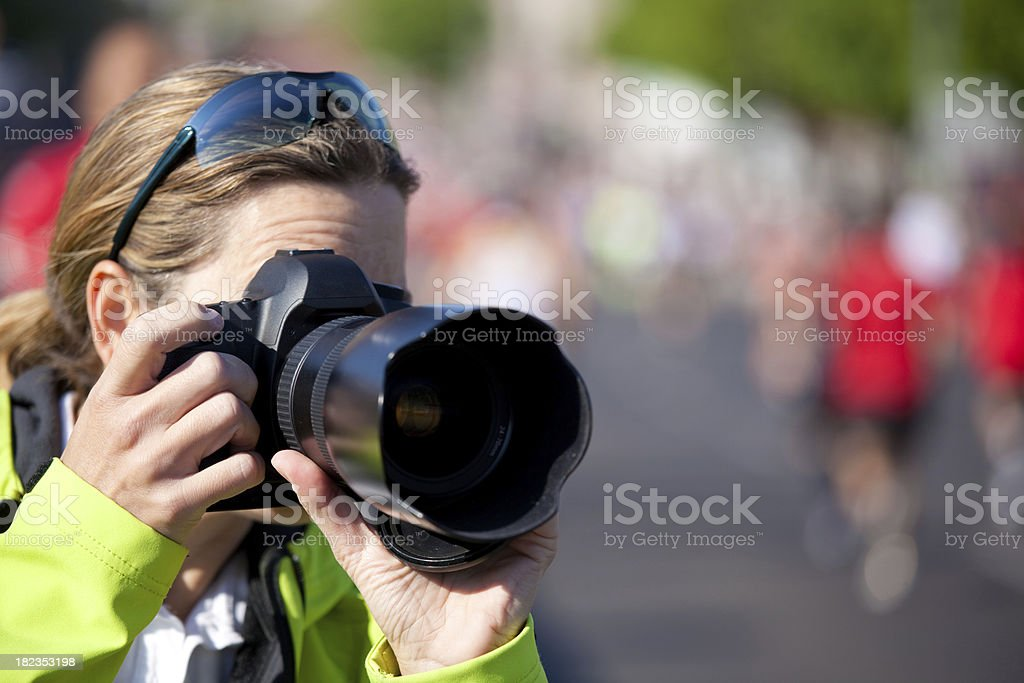 woman taking pictures of sports event stock photo