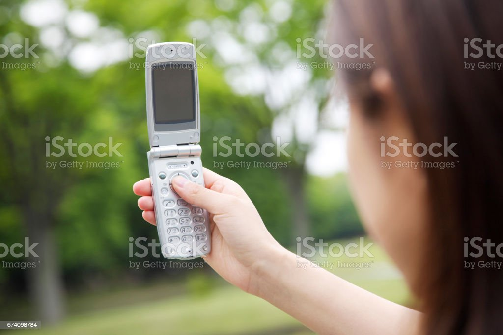 Woman taking pictures with mobile royalty-free stock photo