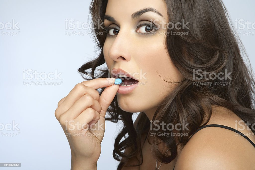 Woman Taking Pills stock photo