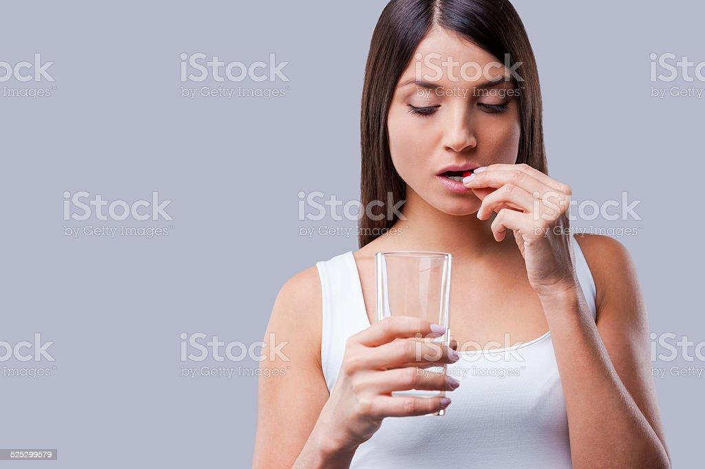 Woman taking pills. stock photo