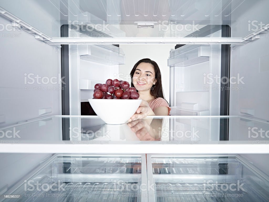 Woman Taking Red Grape royalty-free stock photo