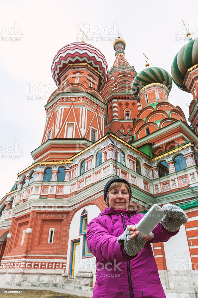 Woman Taking Self Portrait Against St. Basil's Cathedral, Moscow, Russia stock photo
