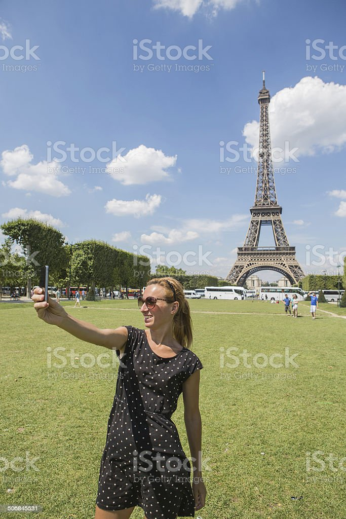 Woman taking selfie front of Eiffel tower,PAris royalty-free stock photo