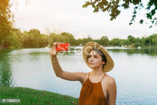 Young Caucasian woman taking selfie in Lumpini Park, Bangkok, Thailand