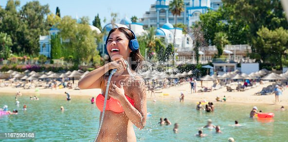 545091450istockphoto Woman taking shower, after swimming in sea 1167590168