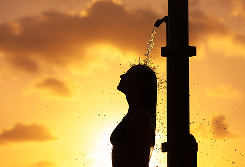 545091450 istock photo Woman taking shower outdoors 528959828