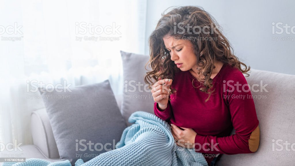 Woman taking the medicine and pills because of painful stomach ache....
