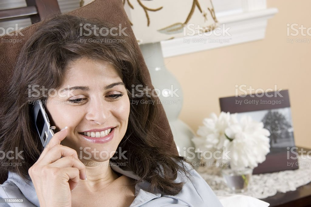 Woman Talking in Bed royalty-free stock photo