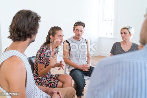 istock Woman talking in group therapy session 923258906