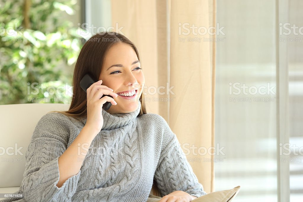 Woman talking on a land line phone stock photo