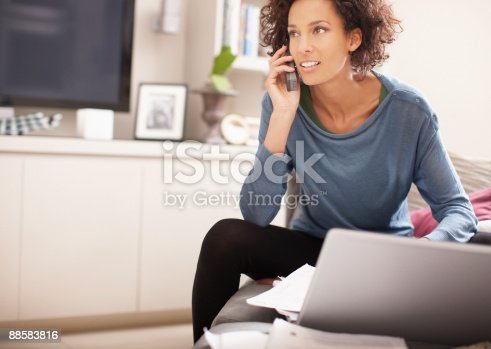 istock Woman talking on cell phone at home 88583816