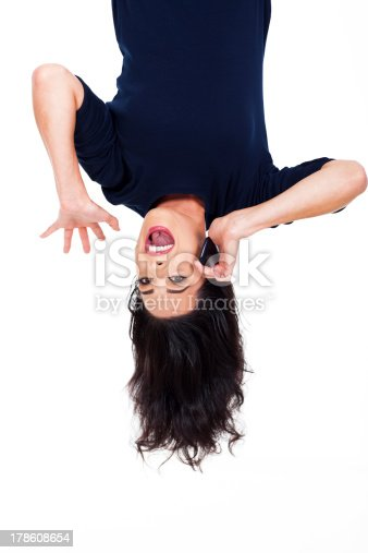 istock woman talking on cellphone upside down 178608654