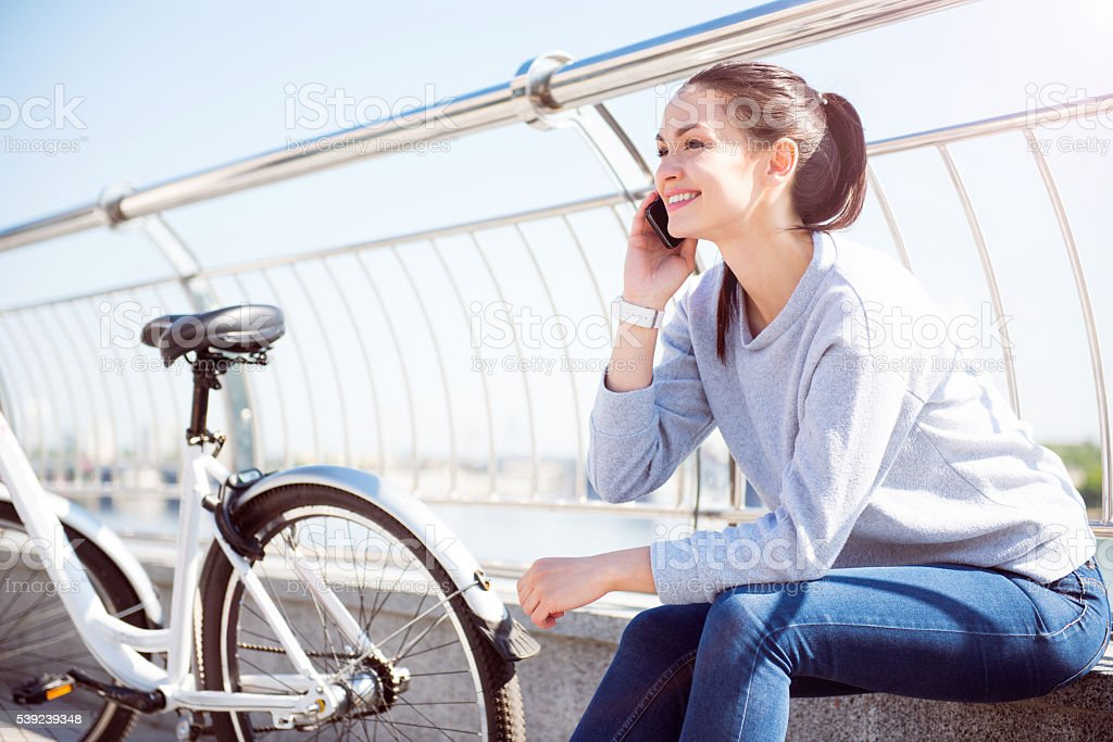 Woman talking on her smartphone royalty-free stock photo