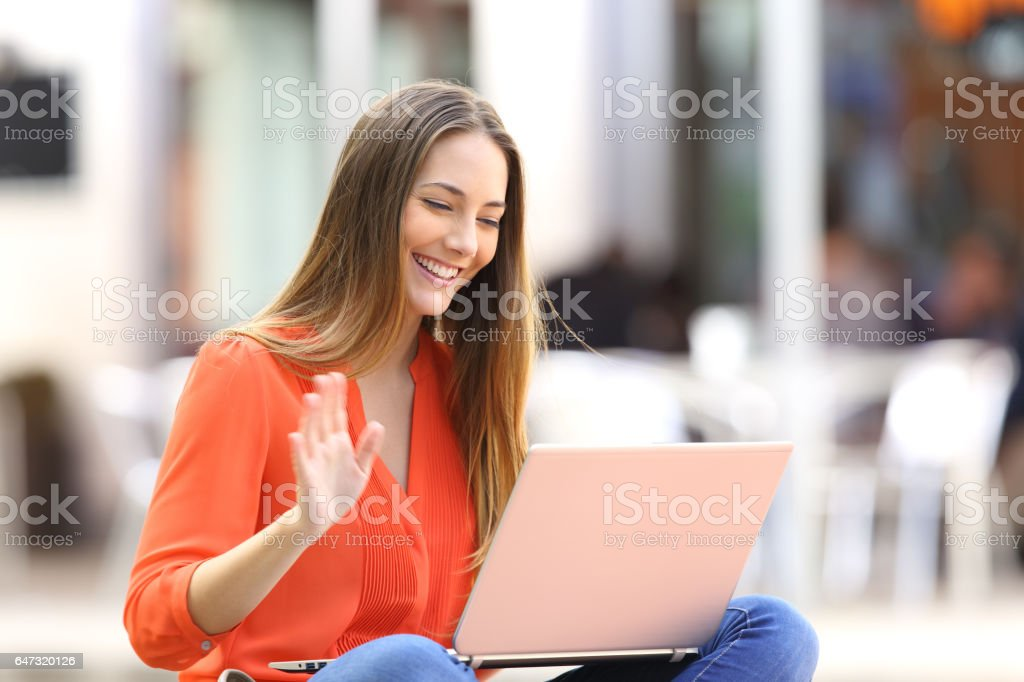 Woman talking on line in a video conference stock photo