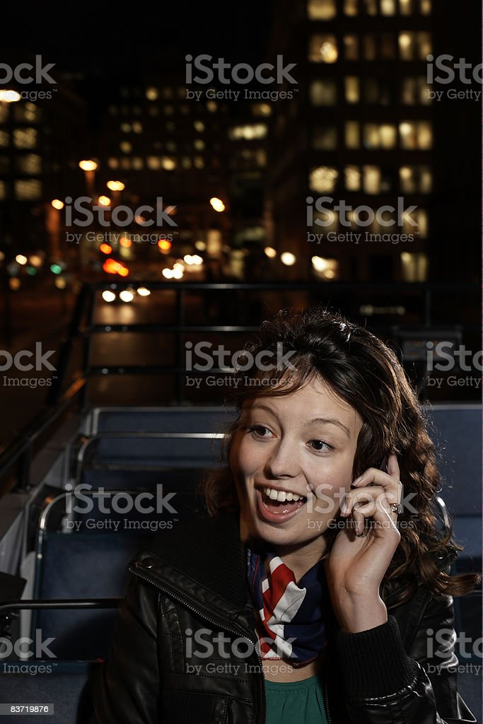 Woman talking on mobile on open top bus royalty-free stock photo