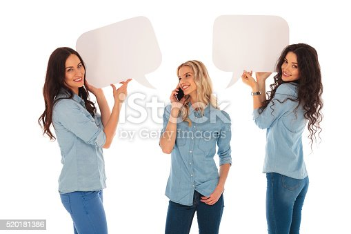 istock woman talking on  phone and her friends  holding speech bubbles 520181386