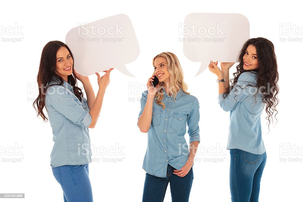 woman talking on  phone and her friends  holding speech bubbles stock photo