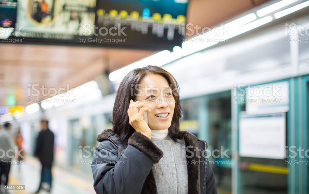 Woman Talking On Phone in Subway royalty-free stock photo