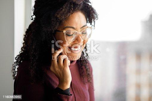 1150572074istockphoto Woman talking on phone 1160883950