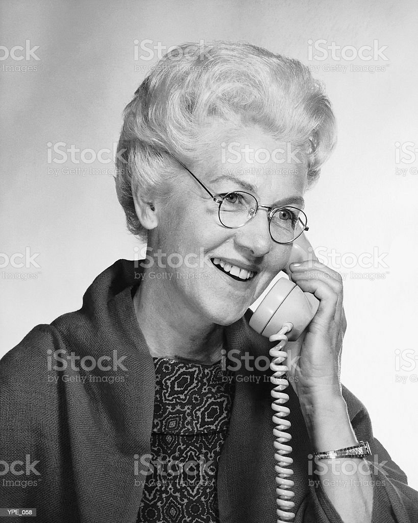 Woman talking on phone royalty-free stock photo