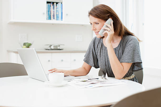 Woman talking on telephone  cordless phone stock pictures, royalty-free photos & images