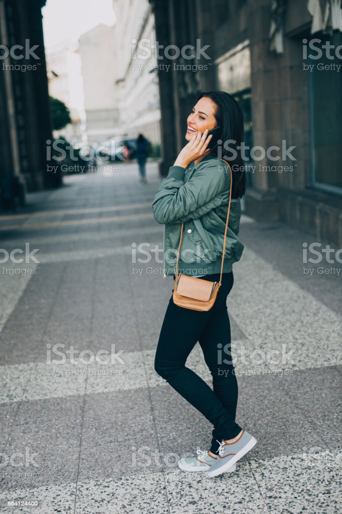 Woman talking on the phone outdoors royalty-free stock photo