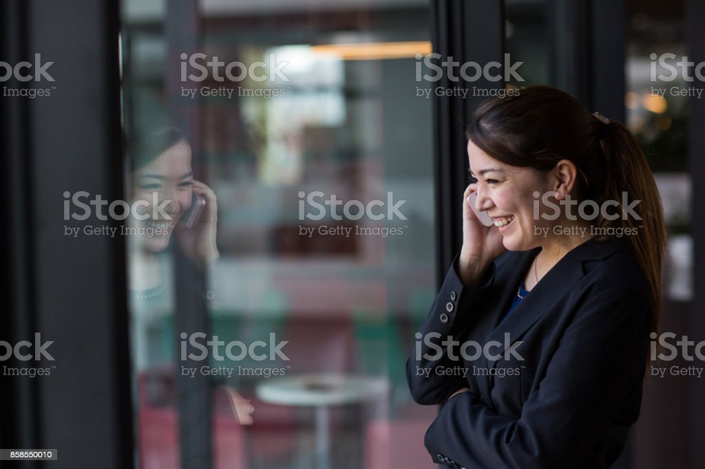 A woman talking on the phone stock photo