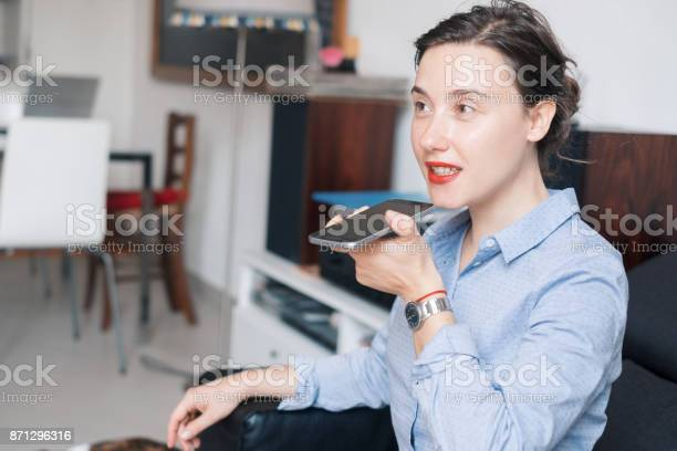 Woman Talking On The Phone With Digital Voice Assistant Stock Photo - Download Image Now