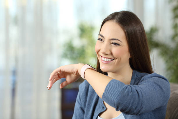 Woman talking to a smartwatch stock photo